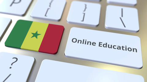 Online Education text and flag of Senegal on the buttons on the computer Live Action