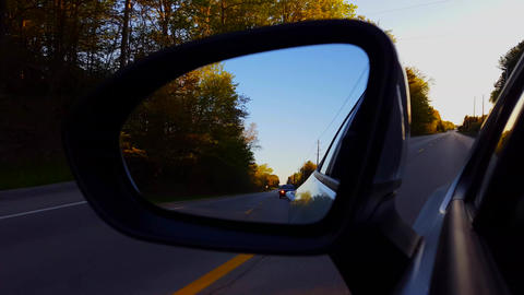 *Reverse Motion* Side View Mirror Driving Rural Country Street in Day. Driver Point of View POV Rear Live Action