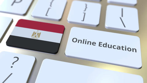 Online Education text and flag of Egypt on the buttons on the computer keyboard Live Action