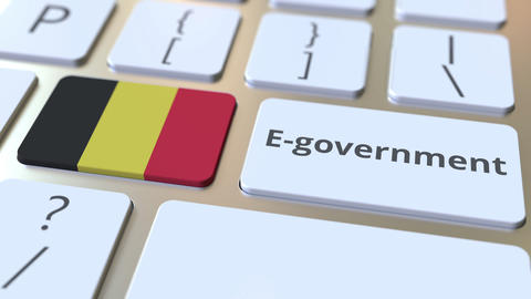 E-government or Electronic Government text and flag of Belgium on the keyboard Live Action