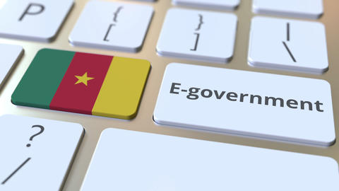 E-government or Electronic Government text and flag of Cameroon on the keyboard Live Action