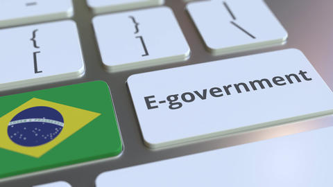 E-government or Electronic Government text and flag of Brazil on the keyboard Live Action