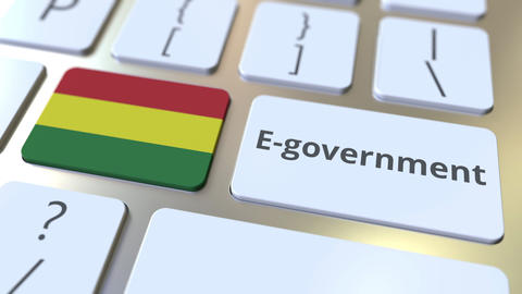 E-government or Electronic Government text and flag of Bolivia on the keyboard Live Action