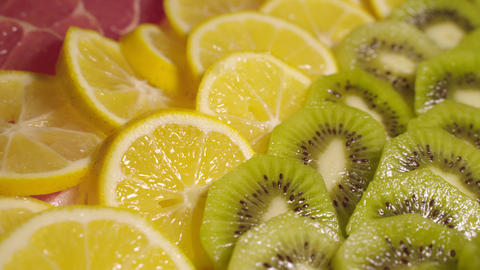 Beautiful and delicious citrus fruits rotating on the plate Live Action