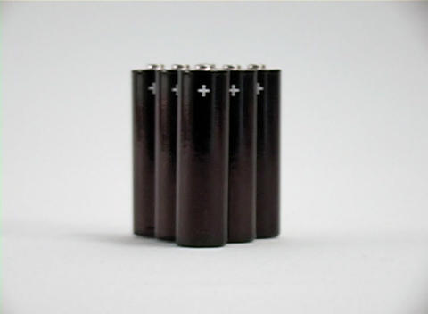 Pan left to right to reveal six batteries for a portable... Stock Video Footage
