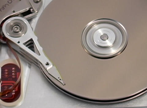 Close up of the inner workings of a computer hard drive Stock Video Footage