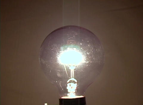 A light bulb slowly becomes illuminated suggesting a new idea Footage