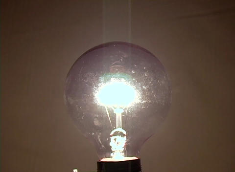 A light bulb slowly becomes illuminated suggesting a new... Stock Video Footage