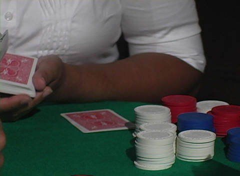 A dolly around a poker game reveals player's cards Stock Video Footage