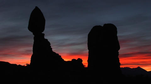 Balanced Rock is silhouetted against the golden-hour sky... Stock Video Footage