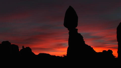 A remarkable balancing rock formation at golden-hour in Arches National Park, Utah Footage