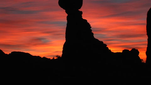 Balanced Rock stands against a brilliant sky in Arches National Park Footage
