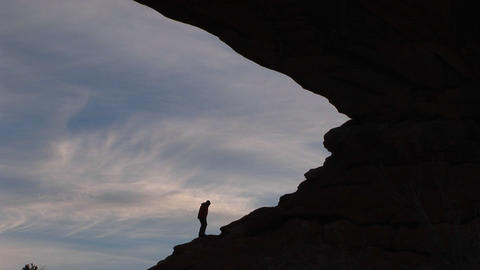 A hiker climbs a rocky slope Stock Video Footage
