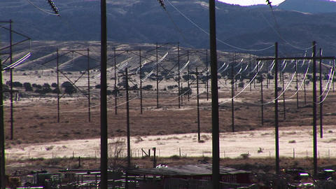Medium shot of power lines run across a Western landscape Footage