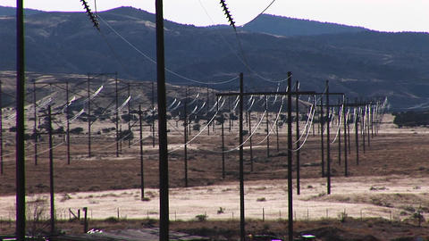 Long-shot of power lines stretching across a Western... Stock Video Footage