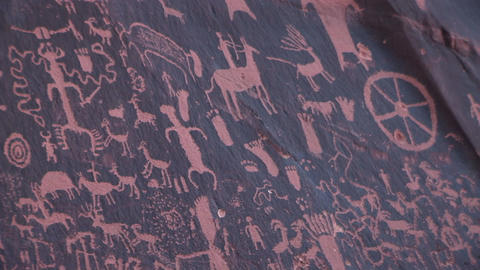 Medium shot of American Indian petroglyphs at Newspaper... Stock Video Footage