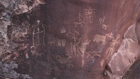Ancient petroglyphs adorn a rock outcropping in the... Stock Video Footage