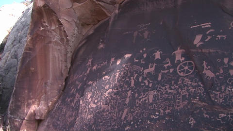 Pan-right across ancient American Indian petroglyphs at... Stock Video Footage