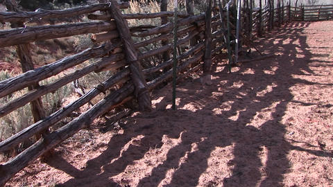 Close-up of an old log fence around an old Western corral Footage