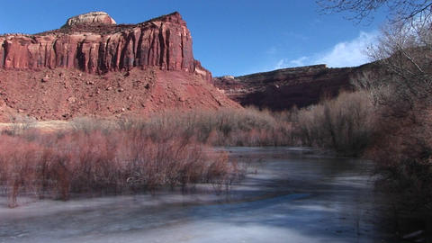 Medium shot of a butte and a frozen stream in Southern Utah Footage