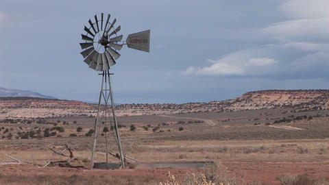 Medium shot of an old windmill standing on a desert plain Stock Video Footage