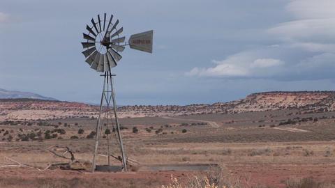 Medium shot of an old windmill standing on a desert plain Stock Video Footage