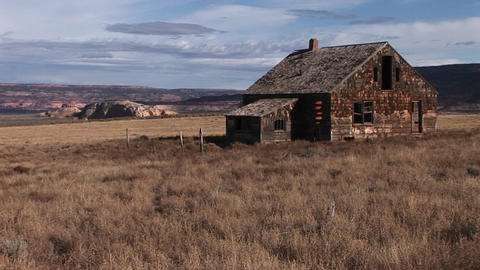 An abandoned settler cabin sits on the plains of America Footage