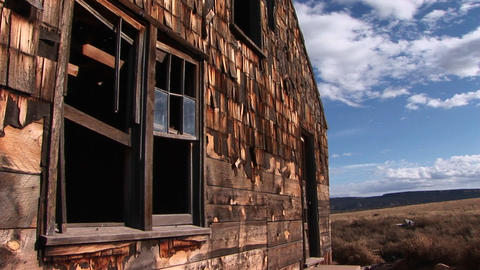 Medium shot of an old abandoned homestead a lonely prairie Stock Video Footage