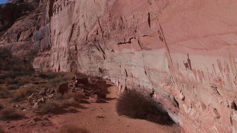 Pan-right slowly across the face of a remote canyon cliff... Stock Video Footage