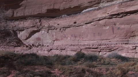 Zoom-in to a remote cliff face revealing large American... Stock Video Footage