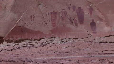 Pan-up of remarkable American Indian petroglyphs on a desert cliff Footage