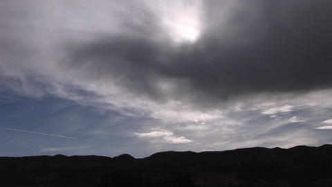 Long shot of sunlight shining through storm clouds Stock Video Footage