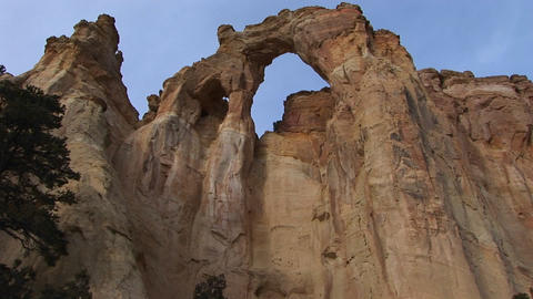Pan-up from a hiker to an enormous stone arch in Southern... Stock Video Footage