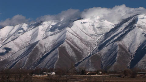 Long shot of snowcapped mountains near Provo, Utah Footage