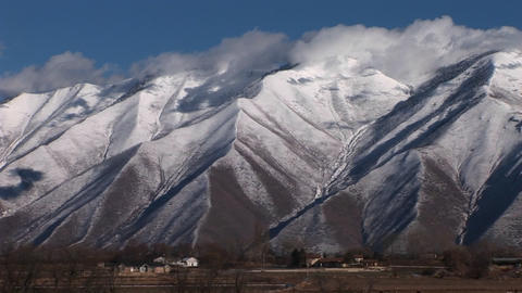 Long shot of snowcapped mountains near Provo, Utah Stock Video Footage