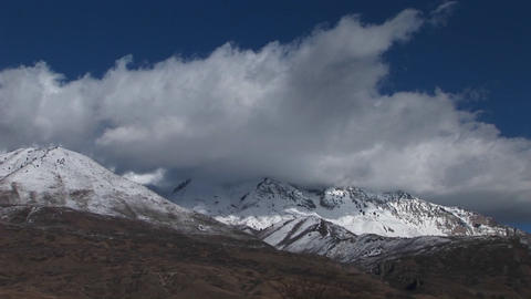 Long shot of snowcapped mountains in Southern Utah Stock Video Footage