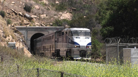 A Amtrak Passenger Train Passes Through A Hillside Tunnel Near Los Angeles stock footage