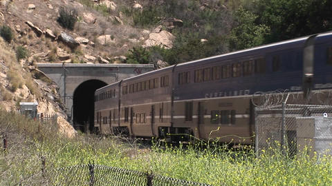 A Amtrak passenger train passes through a hillside tunnel... Stock Video Footage
