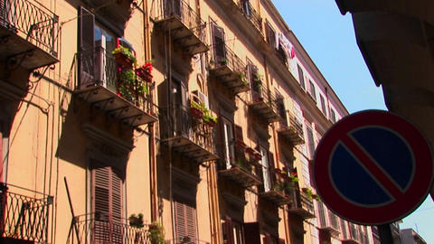 An alley between apartments with balconies and flowers... Stock Video Footage