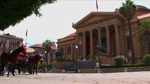 Horses and a carriage wait outside a historic rock... Stock Video Footage