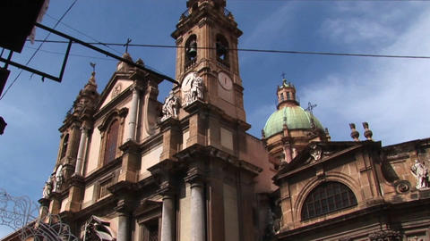 A low angle of a religious building below a cloudy blue sky Palermo, Italy Footage