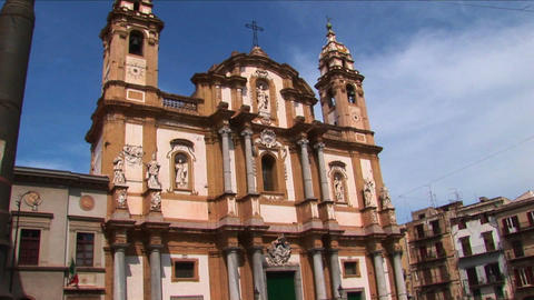 A religious building below a cloudy blue sky Palermo, Italy Footage