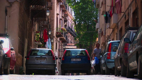 A street between apartment buildings and vehicles... Stock Video Footage