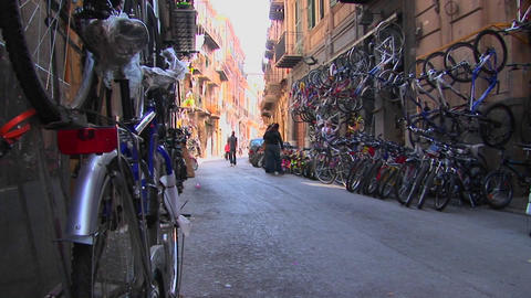 Many bicycles are lined on the street and against the sides of apartment buildings Palermo, Italy Footage