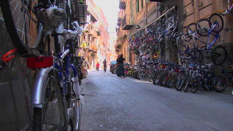 Many bicycles are lined on the street and against the... Stock Video Footage