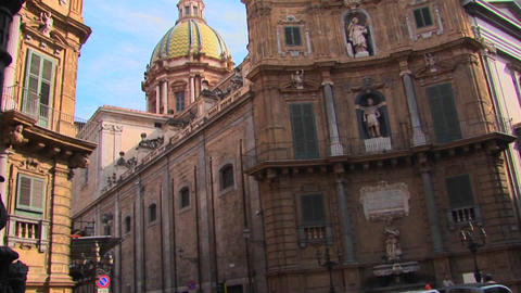 A Roman Catholic Cathedral in Palermo, Italy as seen in the distance on a busy street Footage