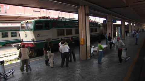 Passengers at a train station prepare to board in Palermo, Italy Footage