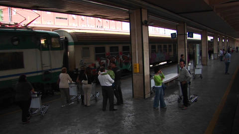 Passengers at a train station prepare to board in... Stock Video Footage