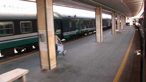 A POV from a train of people walking under an overhang at... Stock Video Footage