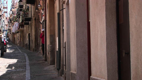 An alley between closely placed houses with clothes... Stock Video Footage
